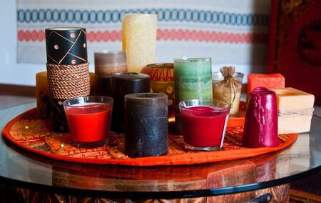 Candles of different shape and colour on a table