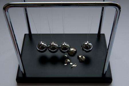 A Newton pendulum with a crashed steel sphere