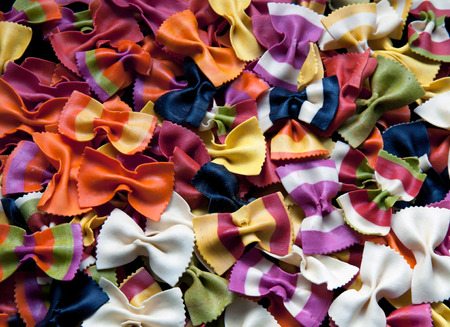 Background of multicolor italian bowtie farfalle pasta