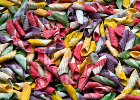 Background of Italian multicolor garganelli pasta