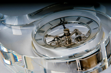 Detail of a skeleton clock included in a glass block drop shaped