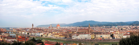 A panoramic view of the city of Florence in Italy with rive Arno in the foreground. Archivio Fotografico