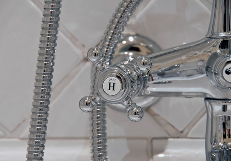 detail of a vintage victorian chrome hot water tap