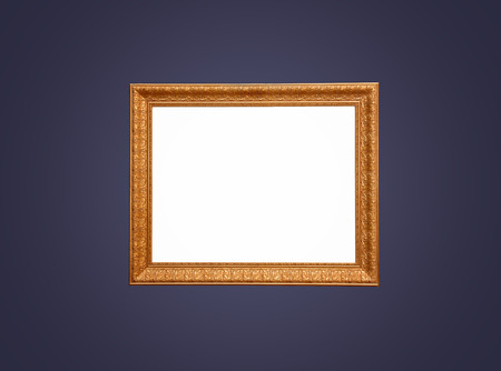An wood and gold leaf empty frame for painting on a dark blue background.