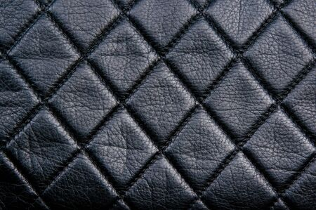 Diamond pattern black leather stitched with black thread Archivio Fotografico