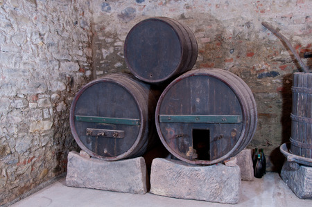 casks: Three old unused wine casks found in an old italian cellar. Stock Photo