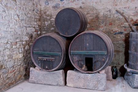 Three old unused wine casks found in an old italian cellar. Archivio Fotografico