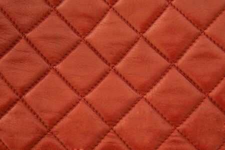 Square pattern red leather stitched with red thread