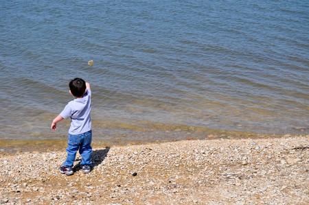 skipping: Boy Skipping Stone on Left