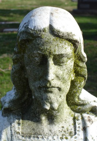 Jesus Statue inside a cemetary - head and shoulders Imagens