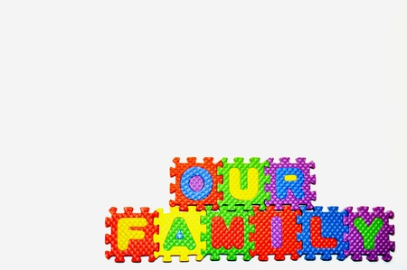 our: Our Family connected blocks lower right hand corner Stock Photo