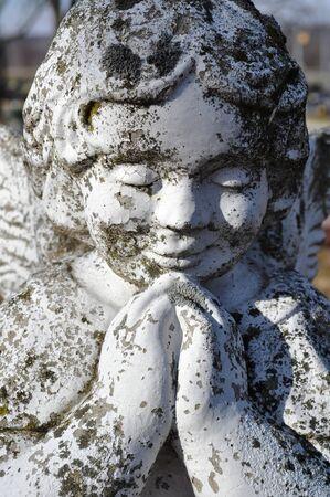 gravesite: Gravesite - Angel - praying - closeup Stock Photo