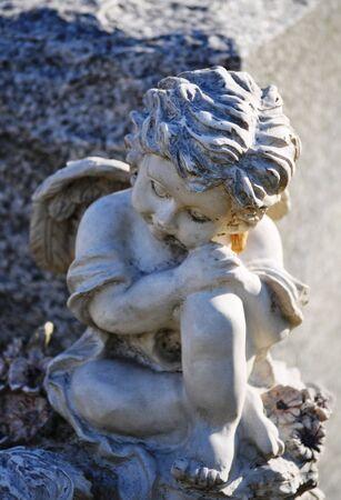 gravesite: Gravesite - Angel on tombstone close up