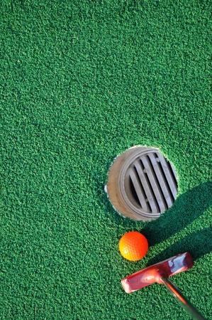 Mini golf and green background Standard-Bild