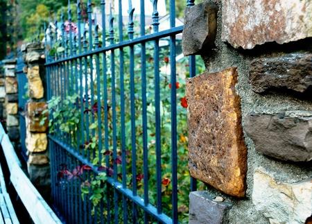 Wrought Iron and Stone Fence photo