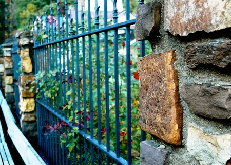 Wrought Iron and Stone Fence Banco de Imagens