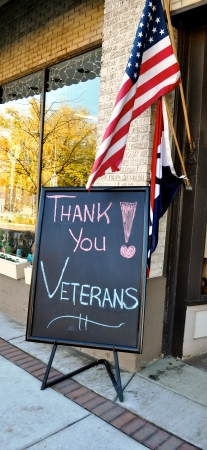 Thank You Veterans Sign and flag Standard-Bild