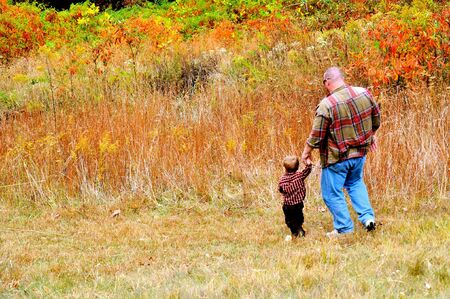 Father and Son walk down the hill photo