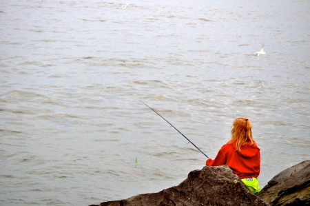 erie: Woman fishes on Lake Erie