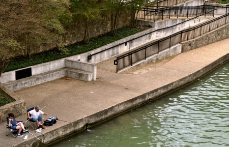 Waco couple fishes on the bank background Stock Photo - 15246442