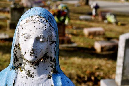 gravesite: Gravesite - Mary statue - background - close-up