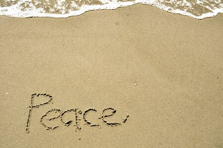 Peace Written in the Sand Stock Photo