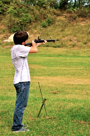 musket: boy aims musket