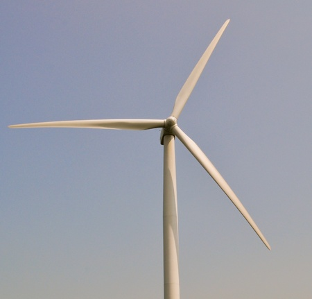 Wind turbine in blue sky photo