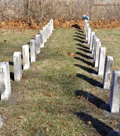headstones: Two lines of cemetery headstones  Stock Photo
