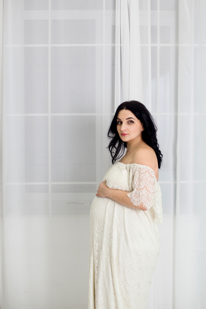 Pregnant woman in white dress