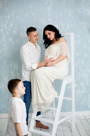 Pregnant women with husband and child