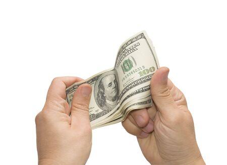 Mens hand holding U.S. dollars, the image isolated on white background Stock Photo