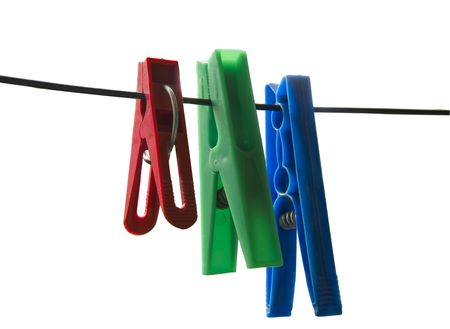 Three plastic clips, red, green and blue hanging on the clothesline on a white background