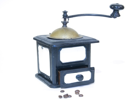 Antique coffee grinder and coffee beans isolated on white background Stock Photo