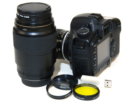 Camera, lens, memory insulated by white background          photo