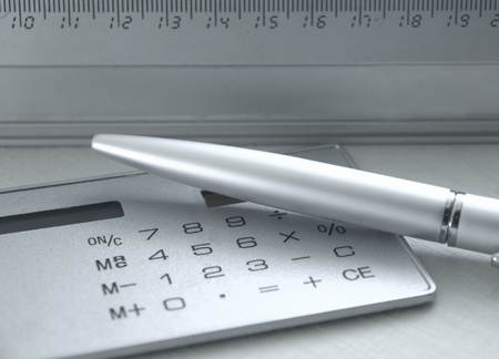 Photo, tools for calculation; the metal handle, calculator, ruler