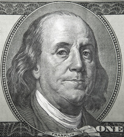 Part of the American  bills which shows Benjamin Franklin, one of U.S. Presidents photo