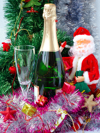 Christmas or New Year. Champagne and gifts on illustrated background Stock Photo