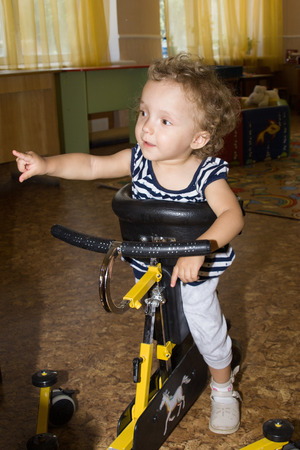 The child on the exercise machine Stock Photo