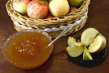 Apple jam on a rustic on whate background