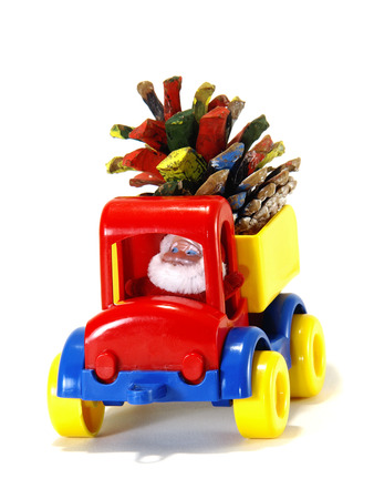 Toys, car-truck and Santa Claus with gifts isolated on white background
