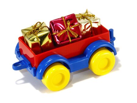 Toys, truck trailer with gifts and toys isolated on white background Stock Photo
