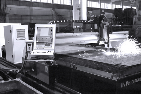 Industrial laser cutting holes in metal sheet