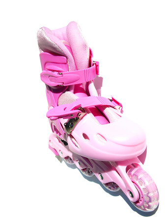 Pink roller skates on a white background Stock Photo