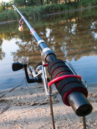 On the banks over the water set fishing equipment to fish comfortably with rod and reel.