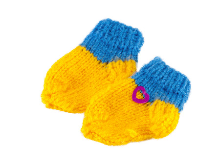 Yellow and Blue baby bootees for little babi beautiful gift, knitted socks for child Stock Photo