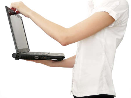 Girl with laptop holding in hands photo