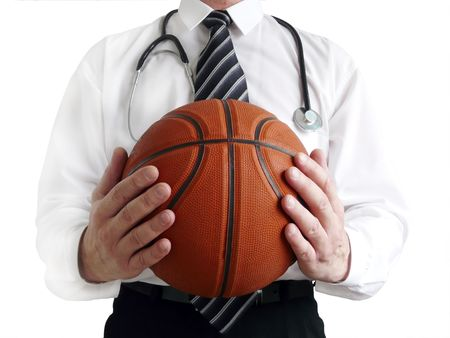 Man doctor with basketball ball in hands