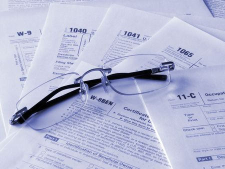 Taxes forms and glasses photo