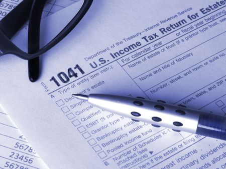 Tax form 1041, glasses and pen photo